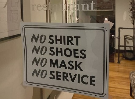 No shirt, no shoes, no mask, no service sign on restaurant door